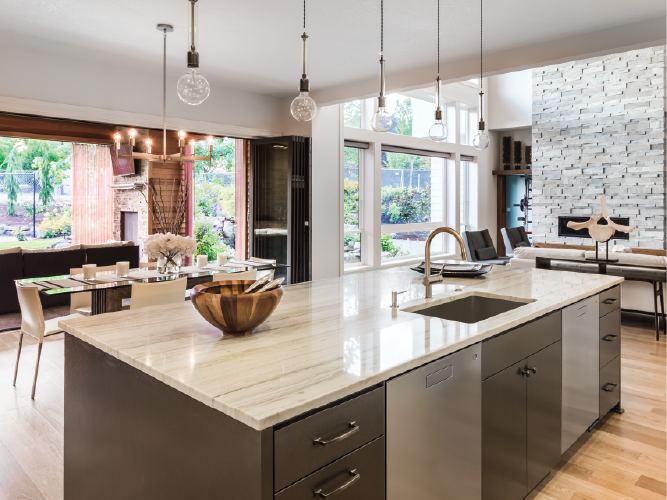 Sleek modern kitchen with stone fireplace