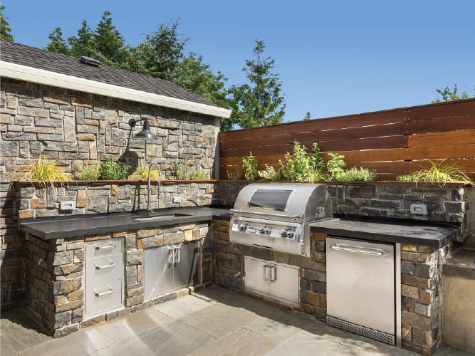Outdoor stone and stainless steel kitchen