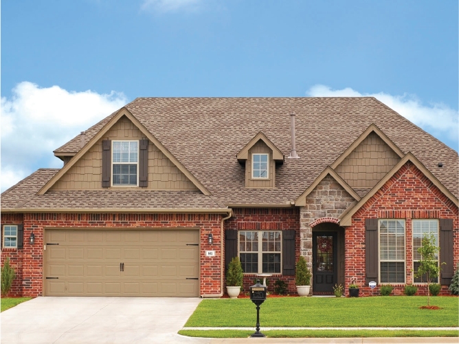 Two story brick home with large roof area